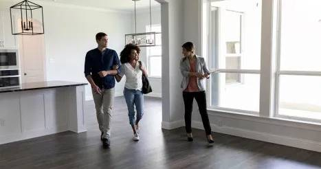 realtor showing home to prospective buyers